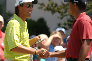 On the first tee Sunday, Stephen Ames congratulates Tiger Woods on winning the PGA Championship.