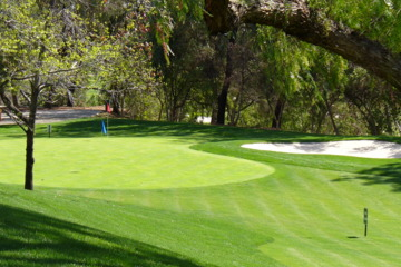Hit a short game practice area, like this one at Industry Hills GC, to work on your chipping.