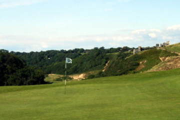 Pennard Golf Club overlooks a valley and 12th-century castle ruins.