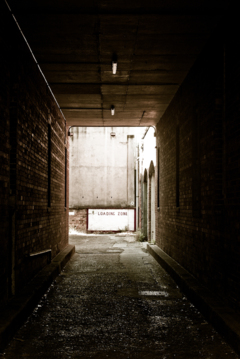 This back alley is currently unoccupied, should you feel the need to violently destroy your golf competition.