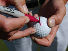Draw a line on your golf ball with a permanent magic marker to help make it easier to see a straight line.