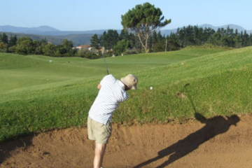 Two reasons we can't get the ball out of the sand: Improper follow-through, or taking too much sand.