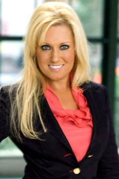 "Natalie Gulbis has gone from bikinis to power suits on ""Celebrity Apprentice."""