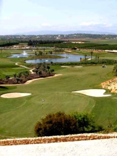 The Monchique Mountains serve as a backdrop to the O'Connor Course at Amendoeira Golf Resort in Portugal.