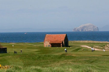 Historic Dunbar Golf Club in East Lothian, Scotland, features 14 holes that play alongside the sea, in view of the Bass Rock offshore.