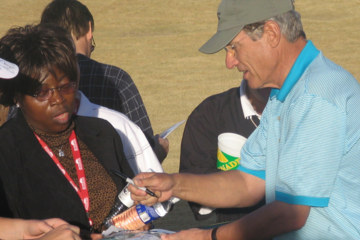 Maury Povich signs for a fan who said she attended a PGA Tour celebrity field event to see him.
