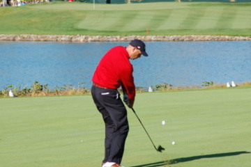 Beginning from the top of your back swing, feel your arms starting to straighten out, fully extending upon impact.