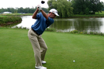 Imagine your backswing as short, wide and tight. As you swing back, make sure your hands are outside your right shoulder halfway back.