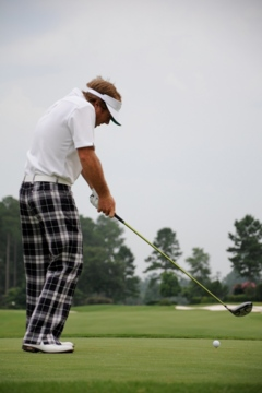 Keeping your weight predominantly behind the ball (notice the back heel) causes the body to spin or over-rotate and the club to come over the top.