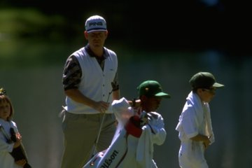 If Jeff Maggert could remove one thing from this picture, would it be his kids or beautiful and prestigious Augusta National?
