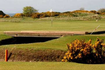 The Swilcan burn lies in front of the first green on the Old Course at St. Andrews.