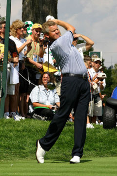 Swing through the golf ball in one smooth motion, applying force late.