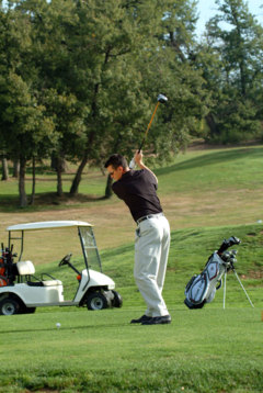 """The  """"feet together, hip-hip"""" exercise helps you swing the clubhead smoothly down and through the ball."""