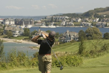 One should always swing the clubhead up and down through the golf ball along the target line to the pin.