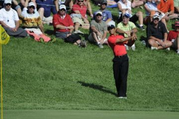 """The """"Tiger Flop"""" on no. 16 at Muirfield Village won The Memorial, Tiger Woods' 73rd PGA Tour win."""
