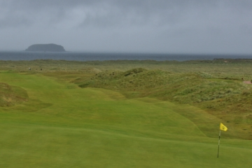 The view back from the 13th green on the Glashedy Links at Ballyliffin Golf Club includes Glashedy Rock off in the distance.