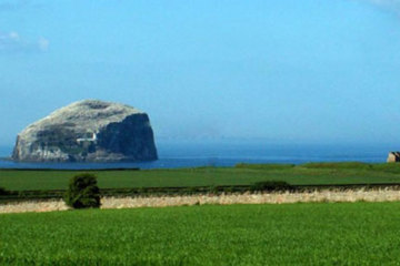 The unusual Bass Rock lies just off the coast of the North Berwick Golf Links 25 miles outside Edinburgh.