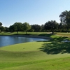 A view of a green with water coming into play from left at Colonial Country Club