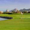 A view of a green with water coming into play at Cabo San Lucas Country Club with clubhouse in background