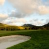 A view of green protected by bunkers at Dairy Creek Golf Course
