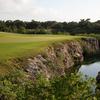 A view of green #10 with waves coming into play at El Camaleon Mayakoba Golf Club