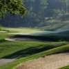 A view of a green guarded by bunkers at The Fort Golf Resort