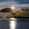 An evening view of the clubhouse with water fountain in foreground at Midway Par-3