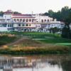 A view over the water of the clubhouse at Congressional Country Club