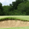 A view of a hole protected by a bunker at Sunset Golf Club