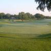 A view of a green a and a fairway at Dallas Athletic Club