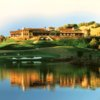 A view over the water of the 18th green and clubhouse at Mayacama Golf Club