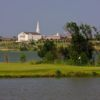A view of a green surrounded by water at Prairie Lakes Golf Course
