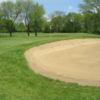 A view of a green protected by a large bunker at Bristol Oaks Golf Club and Banquet Center