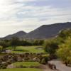 A view of a green flanked by sand traps at Boulders Golf Club & Resort