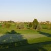 A sunny view of a hole at Emerald Greens Golf Club