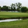 A view of a green surrounded by water at Willow Springs Country Club