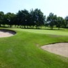 The 12th green and greenside bunkers at Marple Golf Club