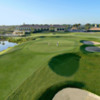 View of a green and clubhouse at LPGA International