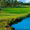 A view of the 4th green surrounded with water on the right side at The Preserve Golf Club