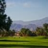View of a fairway and green at Desert Dunes Golf Course
