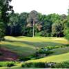 A view over a creek of the 7th hole at Old Waverly Golf Club