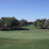 A sunny day view of a hole at Quail Valley Golf Course