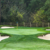 A view of a green surrounded by tricky bunkers at Orinda Country Club