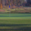A fall day view of a green at UNC Finley Golf Course