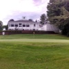 A view of the clubhouse and a hole in foreground at McGregor Links Country Club