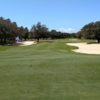 A view of a green protected by tricky sand traps from Club at Hidden Creek